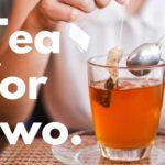 Tea bag steeping in a clear mug