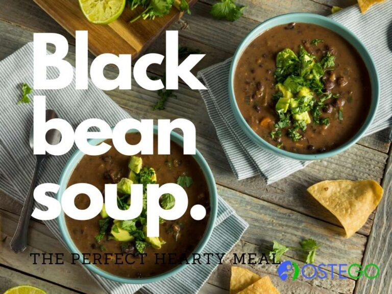 two bowls of black bean soup with cilantro garnish